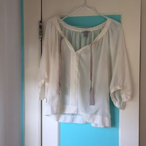 Loose and sheer cream blouse with beige ribbons